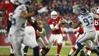 Arizona Cardinals quarterback Carson Palmer (3) scrambles away from pressure against the Seattle Seahawks during the first quarter at University of Phoenix Stadium in Glendale, Ariz. October 23, 2016.