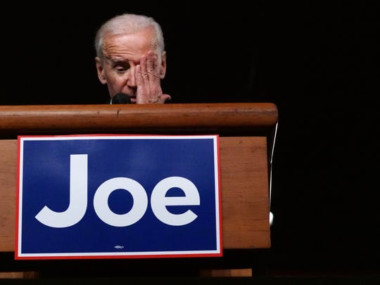 Former Vice President Joe Biden wipes away a tear while addressing a crowd at his welcome back to Wilmington rally on Friday at the Chase Center on the Riverfront.