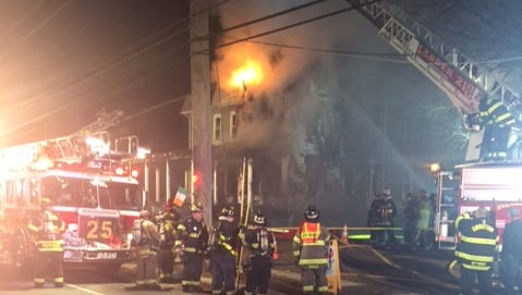 Firefighters respond to a blaze Saturday night on Kings Highway in East Greenwich.