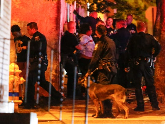 Wilmington police work at the scene of a shooting at Eigth and Windsor streets, reported about 10:55 pm Wednesday.