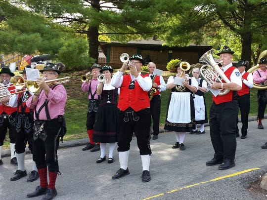 German Band members and their spouses wear traditional Bavarian costumes.