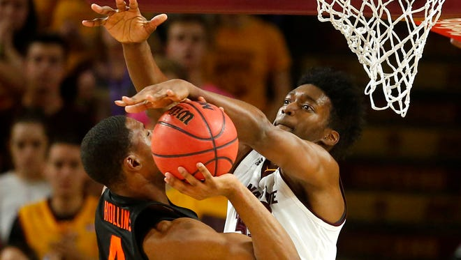 Oregon State's Alfred Hollins has a shot blocked by Arizona State's De'Quon Lake at Wells Fargo Arena in Tempe on Jan. 13, 2018.