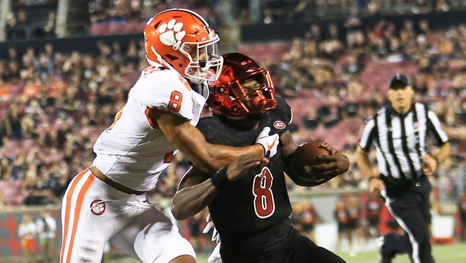 Louisville's Lamar Jackson gets tackled by Clemson's A.J. Terrell in the fourth quarter as the Cards fell 47-21 Sept. 16.