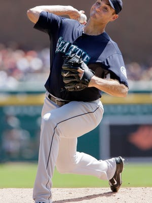 Seattle Mariners' Chris Young pitches against the Detroit Tigers during the first inning of a baseball game on Sunday, Aug. 17, 2014, in Detroit. (AP Photo/Duane Burleson)