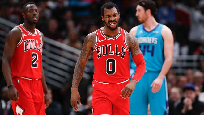 Chicago Bulls guard Sean Kilpatrick (0) reacts after scoring against the Charlotte Hornets during the second half at United Center.