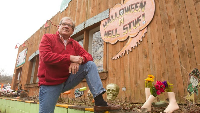 John Colone stands next to one of two buildings still on the market, buildings which draw thousands of people to visit Hell, Michigan.