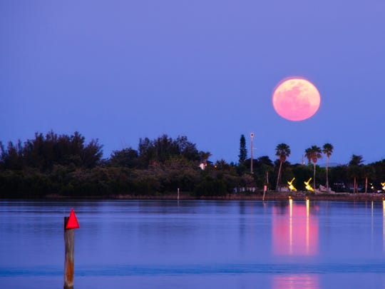 A huge full moon rises the Indian River in this 2011