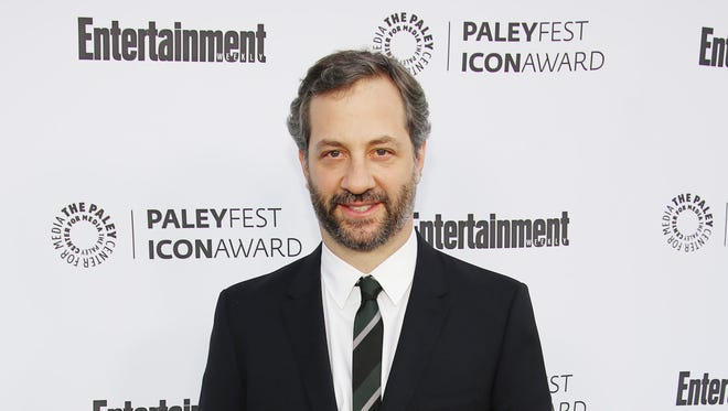 """In this March 10, 2014 file photo, Judd Apatow, 2014 PaleyFest Icon Award recipient, arrives at 2014 PaleyFest Icon Award celebration at The Paley Center for Media, in Beverly Hills, Calif. Netflix says the filmmaker Apatow is co-creating a new series that will take a comic look at modern relationships. Netflix said Tuesday, Sept. 16, 2014, it has made a two-season commitment to the series, titled """"Love."""""""
