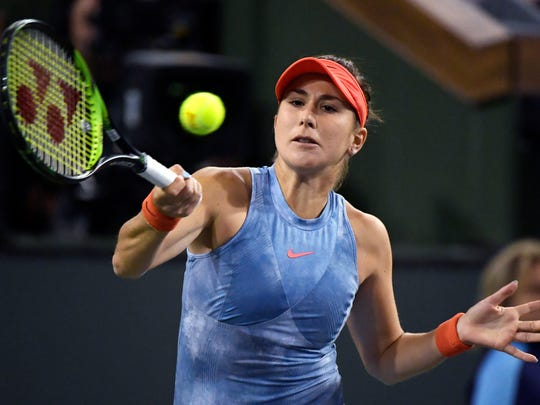 Belinda Bencic, of Switzerland, hits a return to Angelique Kerber, of Germany, at the BNP Paribas Open tennis tournament Friday, March 15, 2019, in Indian Wells, Calif. (AP Photo/Mark J. Terrill)