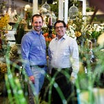 Tim Jordan, left, and Spiro Palmer stand in Palmer Flowers on Wednesday in Fort Collins. Palmer Flowers and Jordan's company, Front Range Flowers, have merged.