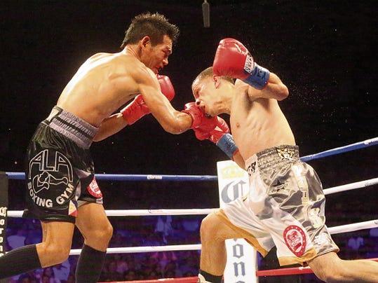 Rudy Gutierrez—El Paso Times McJoe Arroyo, right, throws a left punch to Arthur Villanueva Saturday night in the Don Haskins Center.