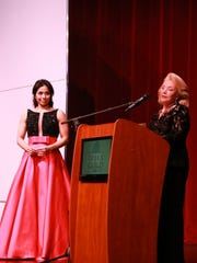 Guadalupe Paz receiving Rossini award from Peggy Cravens.