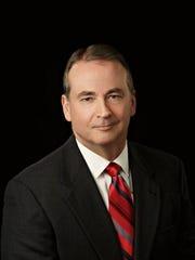 Mark E. Holcomb