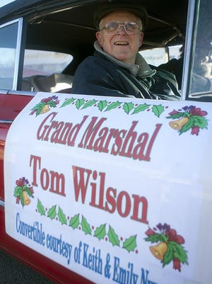 Galesburg Holiday Parade grand marshal Tom Wilson waits for the festivities to begin for the 2013 event. A longtime Register-Mail columnist, Wilson died Tuesday afternoon at Aperion Care Galesburg North. He was 82.