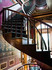The Honolulu House in Marshall features a prominent staircase in the entryway to impress the guests who would enter.