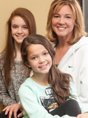 Samantha Slaughter, 12, left, Skylar Slaughter, 10, and their mother, Leisha Slaughter, pose at Dance Designs. <137>Jan., 30, 2013<137>