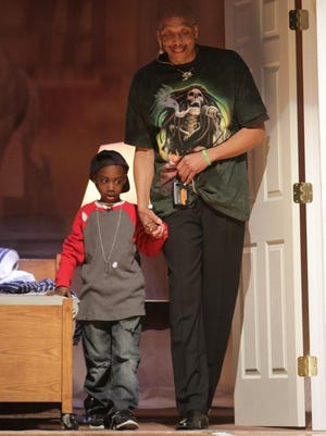 Andre at age 5, portrayed by Jeremy Box, is tempted by Lucifer (Dock Hoffman) in his first foster family home in a rehearsal of the church play.