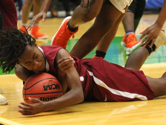 Florida High's Janae Scott dives on a loose ball during