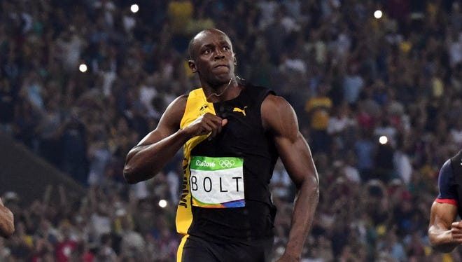 Usain Bolt celebrates after winning the men's 100-meter final.