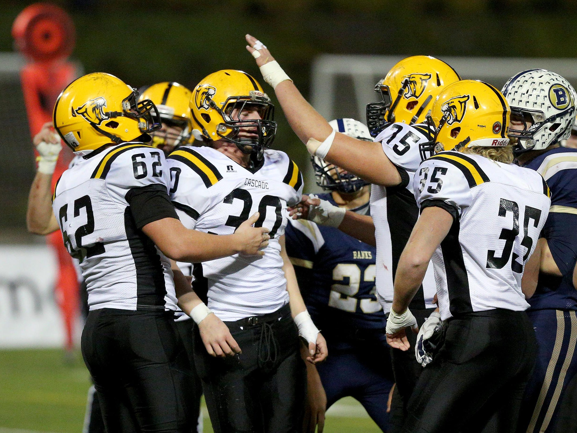 Cascade running back Garrett Coffey (30) is congratulated by his teammates after scoring a touchdown against Banks during the OSAA Class 4A state semifinals, Saturday, November 21, 2015, at Hillsboro Stadium in Hillsboro, Ore. Cascade won the game 42-21.