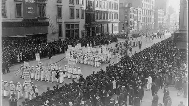 Suffragettes marching in October 1915 in this unidentified city.