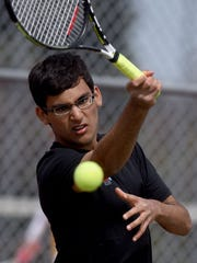 Lincoln's Arjun Choudhry returns the ball to Madison's