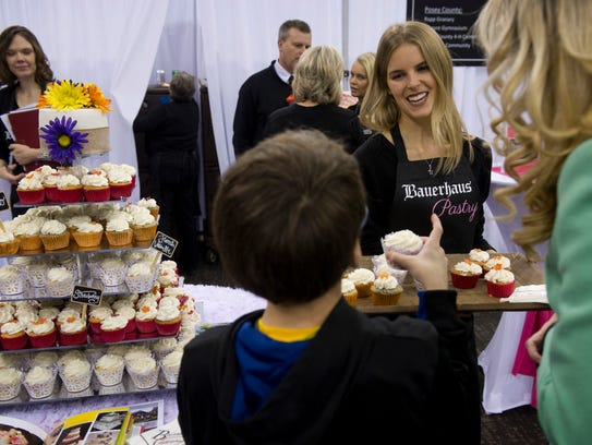 Hadley Bauer with Bauerhaus Pastry offers cupcake samples