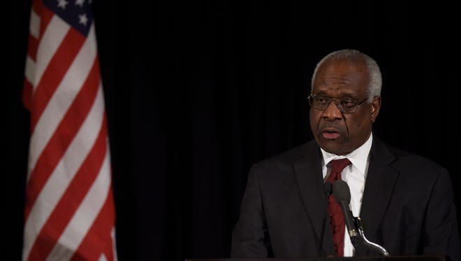 Supreme Court Justice Clarence Thomas speaks at a memorial service for the late Justice Antonin Scalia in Washington in March.