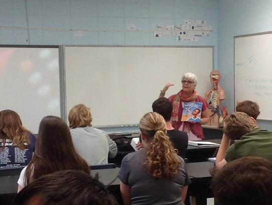 Lisa Vihos speaks to a high school ecology class at
