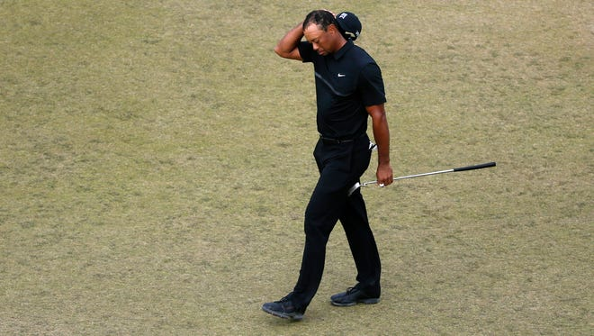 Tiger Woods walks off the 10th green during the first round of the U.S. Open golf tournament at Chambers Bay on Thursday, June 18, 2015 in University Place, Wash.