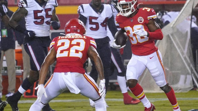 Kansas City Chiefs safety L'Jarius Sneed (38) celebrates with safety Juan Thornhill (22) after an interception during the Chiefs' season opener last Thursday against the Houston Texans at Arrowhead Stadium.