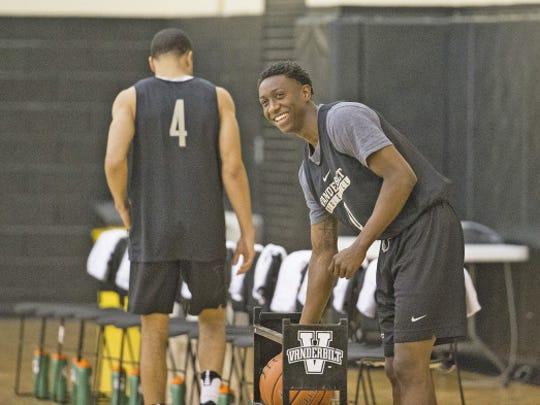 Vanderbilt freshman Saben Lee smiles and grabs a basketball at summer practice alongside Xavier transfer Larry Austin (4) on July 26, 2017.