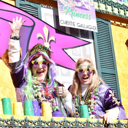 Parade-goers line the road on Monroe Street to watch the 23rd annual krewes parade Sunday.