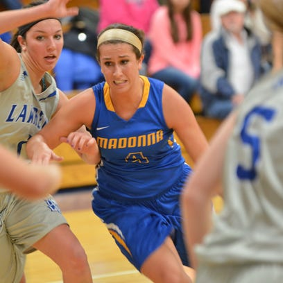 Madonna's Lizzy Otten (middle) scored 11 points in Saturday's 86-82 overtime loss at Lawrence Tech.