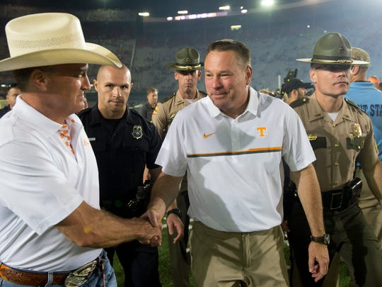 Tennessee head coach Butch Jones is congratulated on his win against Virginia Tech in the Battle at Bristol on Sunday, September 11, 2016. (SAUL YOUNG/NEWS SENTINEL)