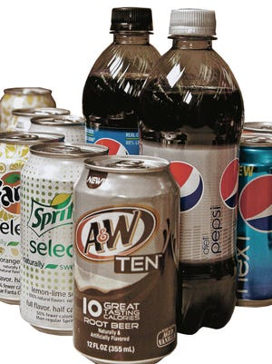 Diet beverage selected for a soda taste test are seen on Wednesday, June 27, 2012 in New York.  The Coca-Cola Co., PepsiCo Inc. and Dr Pepper Snapple Group Inc. have worked to come up with sodas that have fewer calories but still taste good.  (AP Photo/Bebeto Matthews)