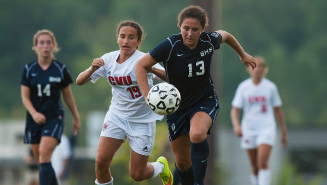 Burlington's Madison Noonan (13) and CVU's Sara Kelley (19) chase down the ball during the girls varsity soccer game on Tuesday in Hinesburg