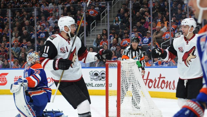 Arizona Coyotes center Martin Hanzal (11) celebrates a goal with right winger Radim Vrbata (17) as Oilers goalie Cam Talbot (33) looks on during the second period at Rogers Place.