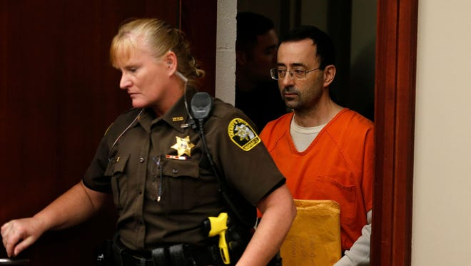 Former Michigan State University and USA Gymnastics doctor Larry Nassar arrives at Ingham County Circuit Court in Lansing, Mich.