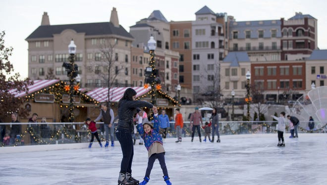 Ice skaters enjoy themselves on an unseasonably warm afternoon on Nov. 29, 2017, at Carmel's Christkindlmarkt.