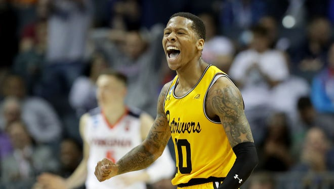 Jairus Lyles of the UMBC Retrievers reacts after a score against the Virginia Cavaliers during the first round of the 2018 NCAA tournament at Spectrum Center on March 16, 2018 in Charlotte, North Carolina.
