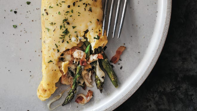 John Currence's fines herbes omelet has Gruyere, ginger and mixed fresh herbs.