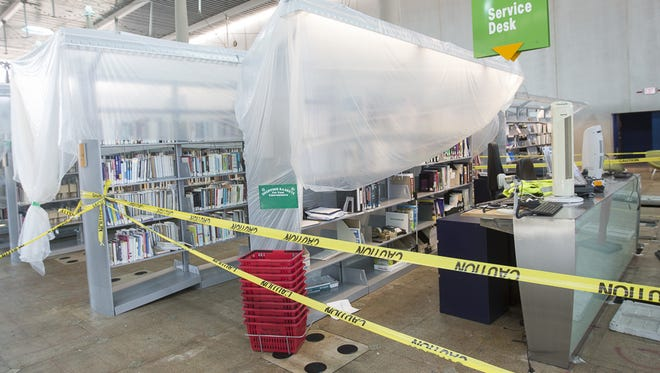 Books sit covered in plastic at the Burton Barr Central Library in Phoenix, on Aug. 18, 2017.