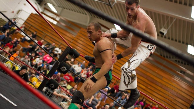"""Robby Collins leaps off of Sless Taylor at ASWA's """"Saturday Night Slam!"""" event on Feb. 6."""