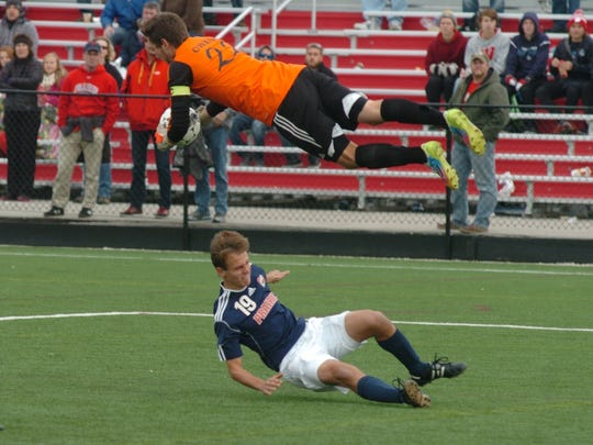 Sturgeon Bay goalkeeper Caleb Owens makes a leaping save against Prairie School during the team's WIAA Division 4 high school soccer state semifinal match. While the Clippers lost, they reached the state tournament for the second straight year and fourth in the last five.