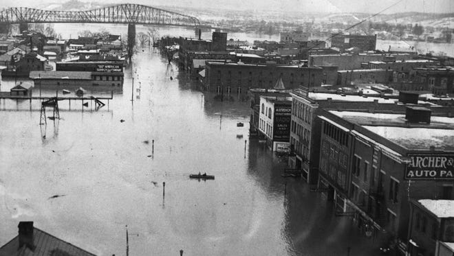 As the waters continued to fill Downtown, some wondered if they would ever stop. In all, the 1937 flood did the equivalent of $8 billion worth of property damage adjusted to 2012 dollars. The waters claimed 385 lives in the Ohio River region.