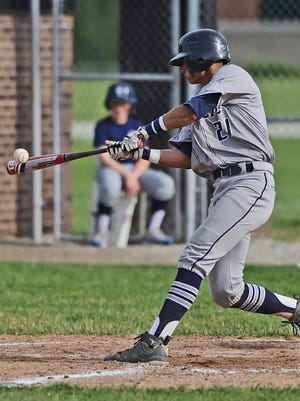 Knights senior Anthony Berumen lays into a pitch Thursday at the Delphi Sectional.