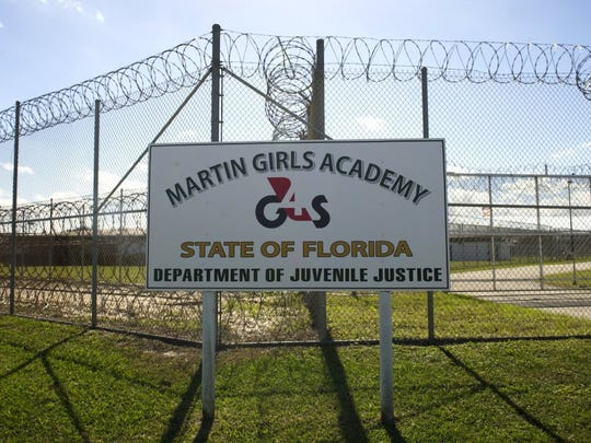 A double fence, lined and topped with razor wire, surrounds the Martin Girls Academy in Stuart. (FILE PHOTO)