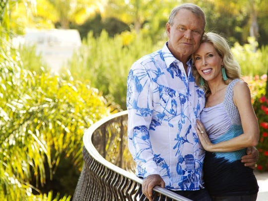 Musician Glen Campbell, left, and his wife, Kim, pose for a portrait in Malibu, Calif., in 2011.