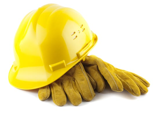Yellow construction helmet and gloves isolated on white
